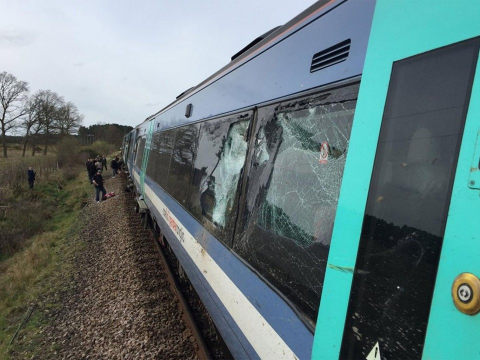 Norfolk train crashes with tractor: Drivers 'seriously injured' as 10 hurt in level-crossing collision